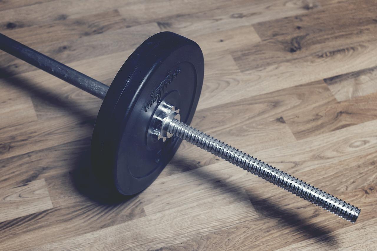 weight lifting brown laminate flooring
